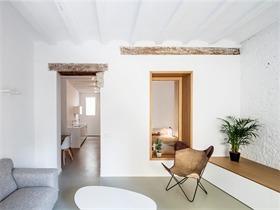 巴塞罗那TS01公寓翻新:提升空间与采光品质,同时保留旧的建筑元素